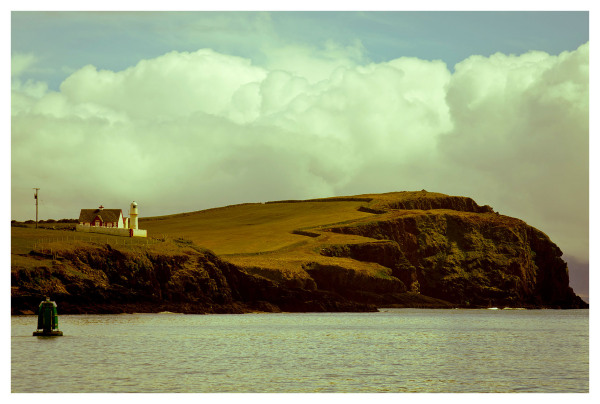 dingle lighthouse postcard style clouds