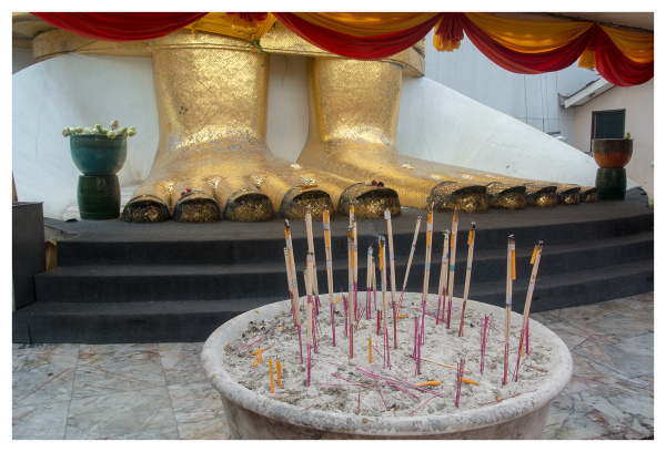 Incense Sticks at Golden Buddha's Feet