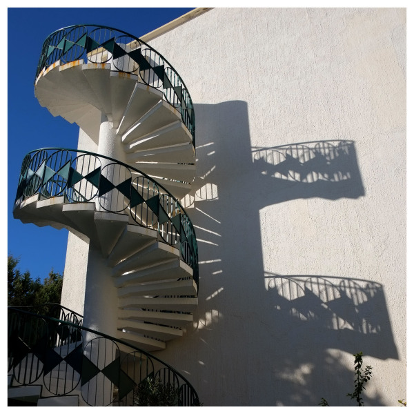 stairs fire escape shadows winter light