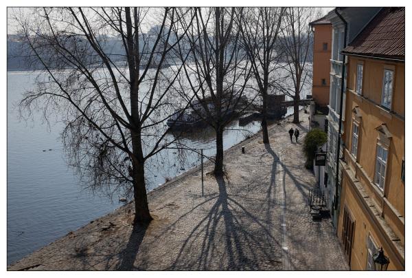 river walk cobbles spring light prague