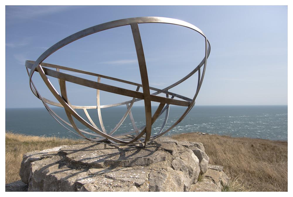 circles metal light sea cliff edge sky