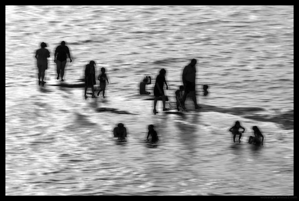 silhouettes swimmers paddling dorset coast art des