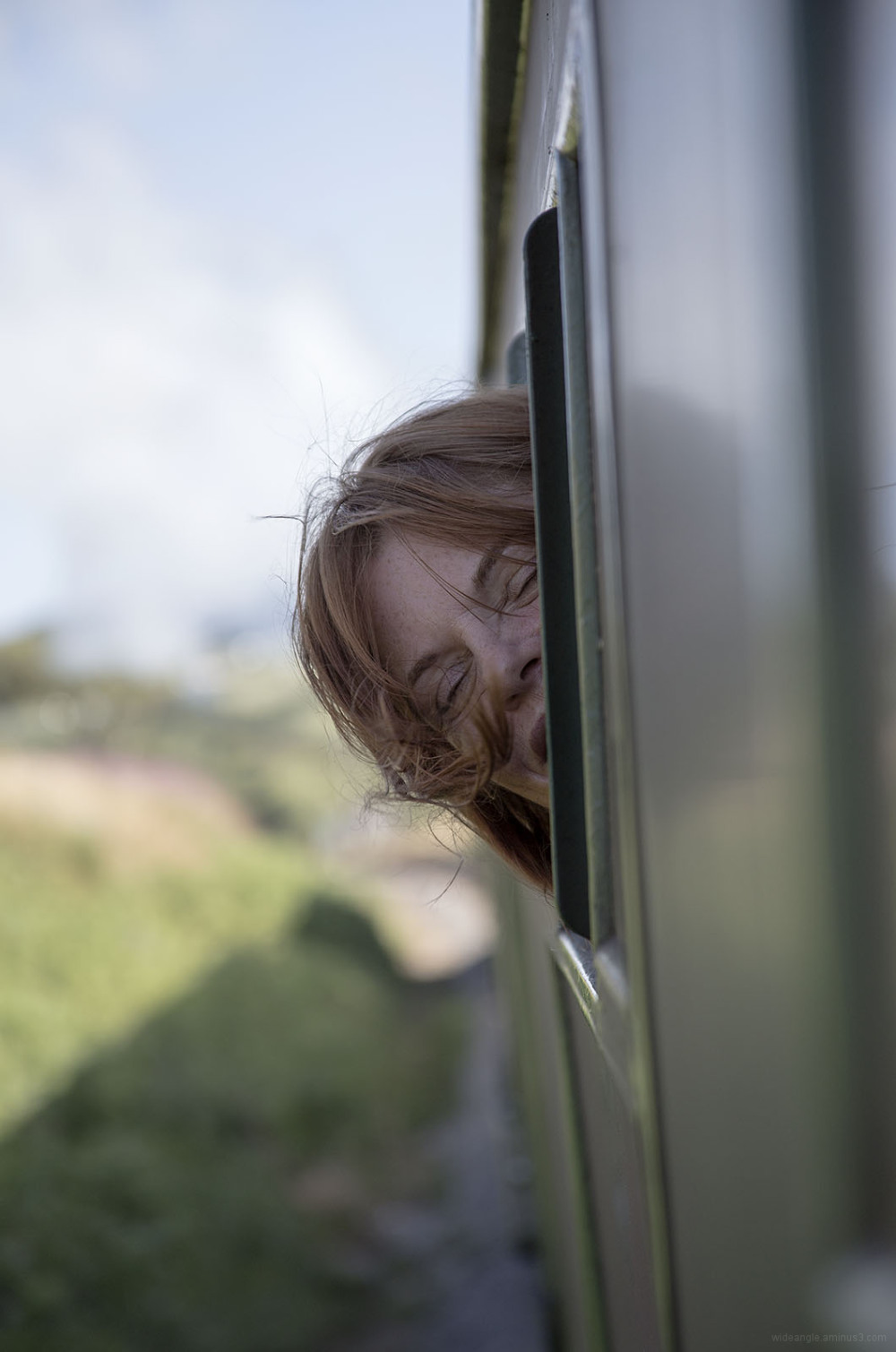 steam train dorset smiling hair blowing woman