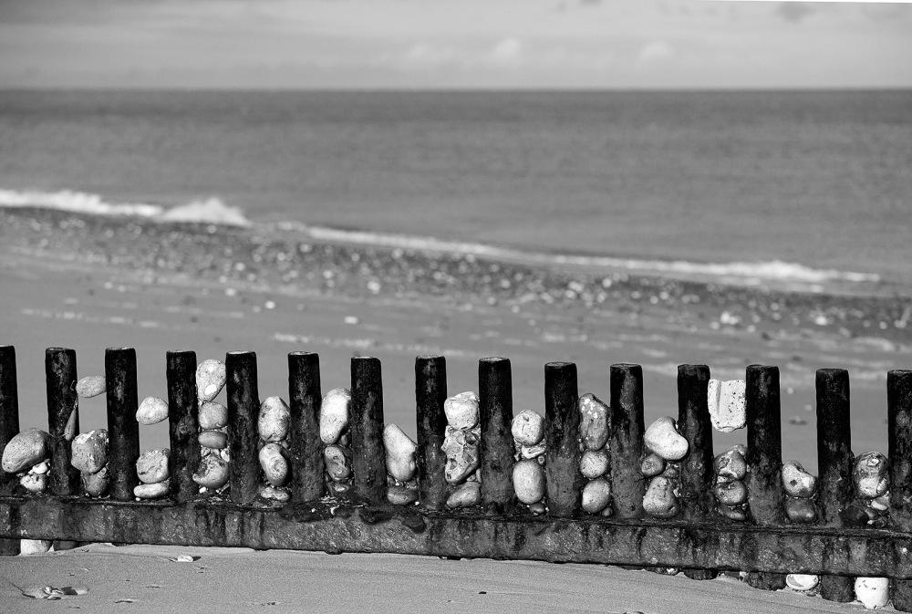 stones trapped sea defences norfolk coast