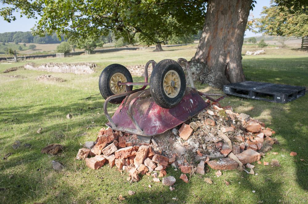 wheelbarrow bricks rubble countryside leicester