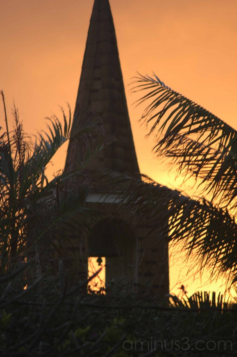 church steeple with sunset