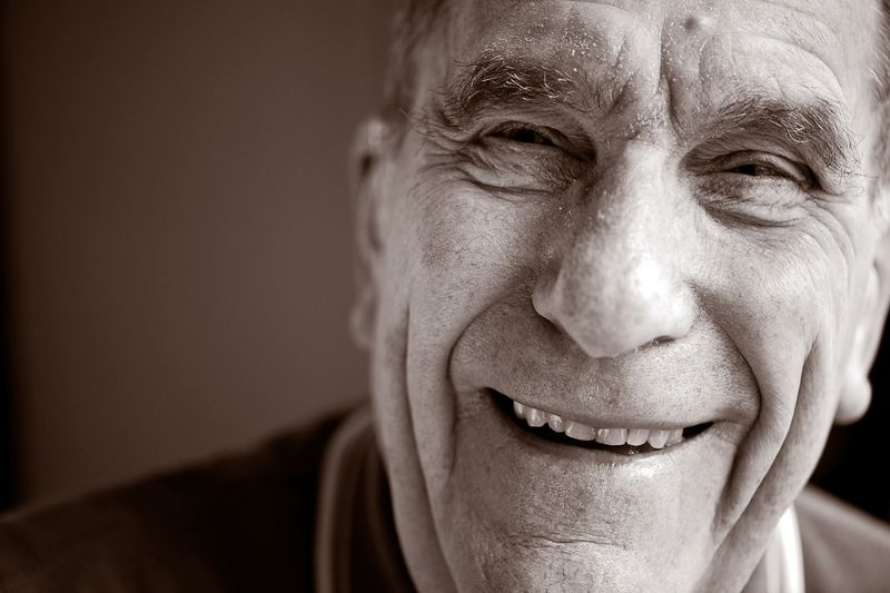 A portrait of an 80 year old man