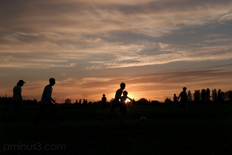 soccer players winnipeg folk festival sunset