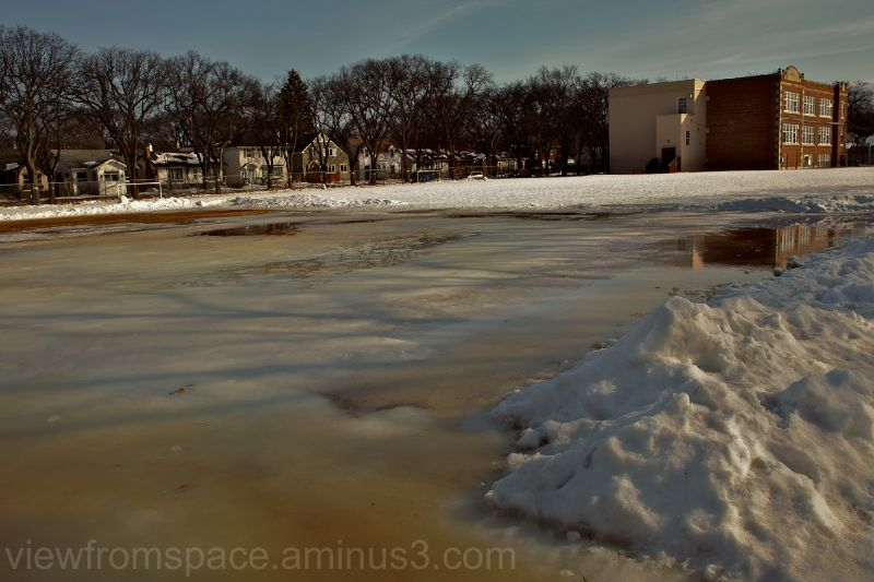 melting ice rink winnipeg canada