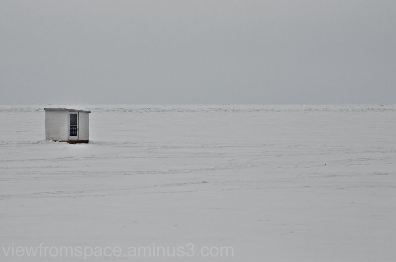 ice fishing lake winnipeg manitoba canada
