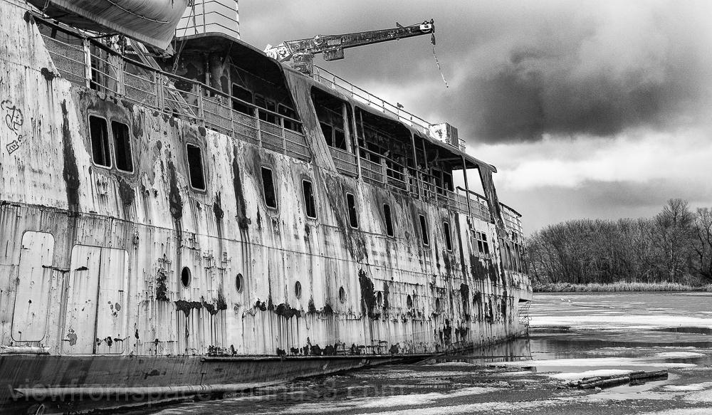 sinking rotting abandoned ship red river manitoba