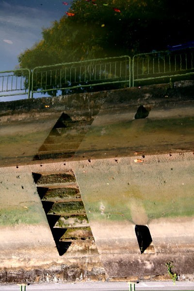 reflection of steps in canal