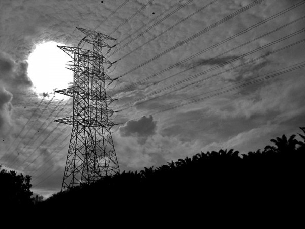 electrical wires against sky in black and white
