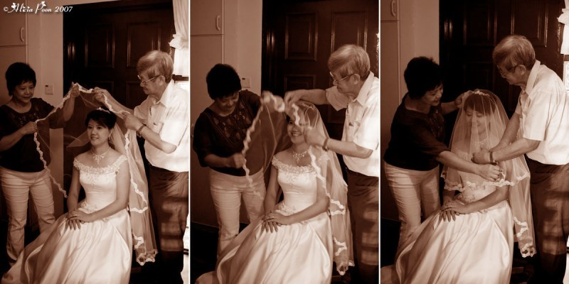 parents putting on the bridal veil in sepia
