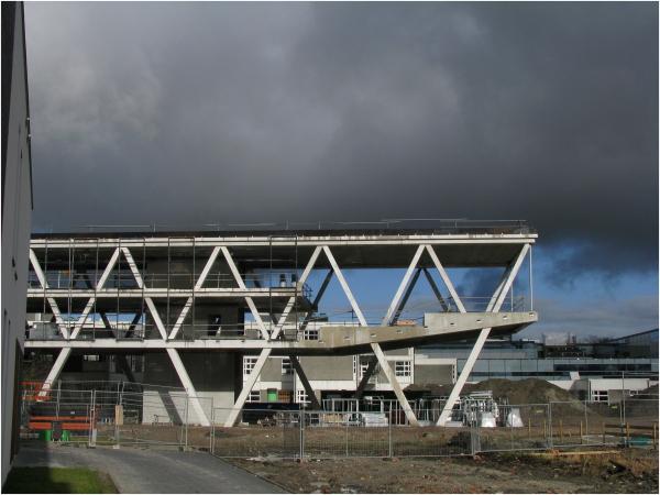construction-site building-site sky clouds school