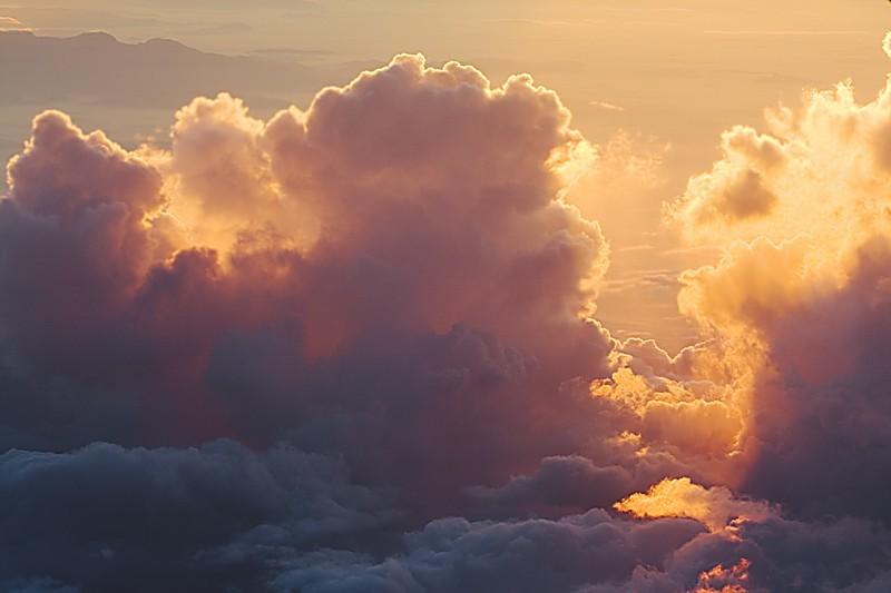 Backlit clouds at high altitude sunset