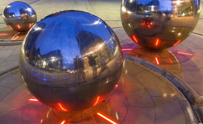sheffield spherical steel sculpture at night
