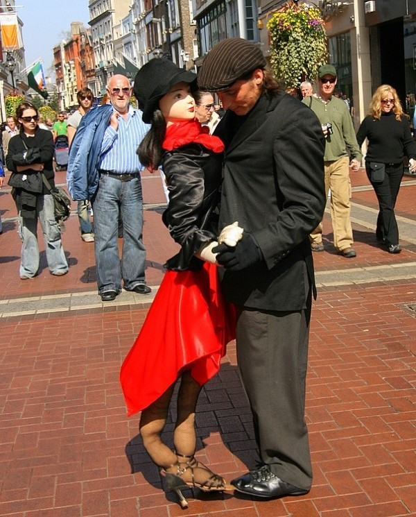 Colourful busker with Tango partner