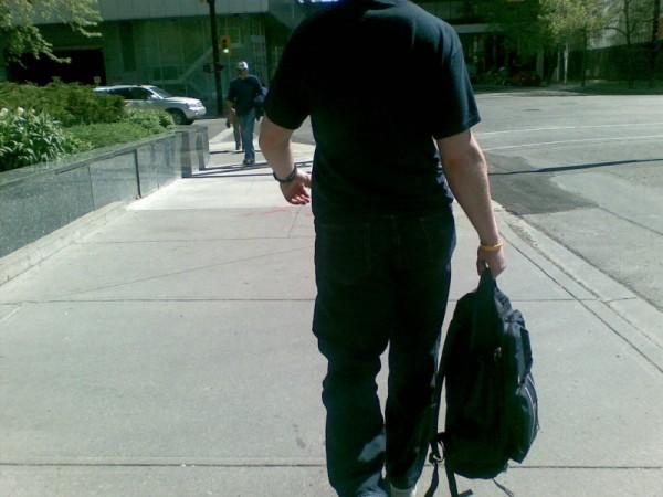 Man Walking down 4th Street S.W. in Calgary