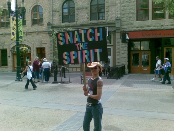 Calgary Pride parade marcher with sign