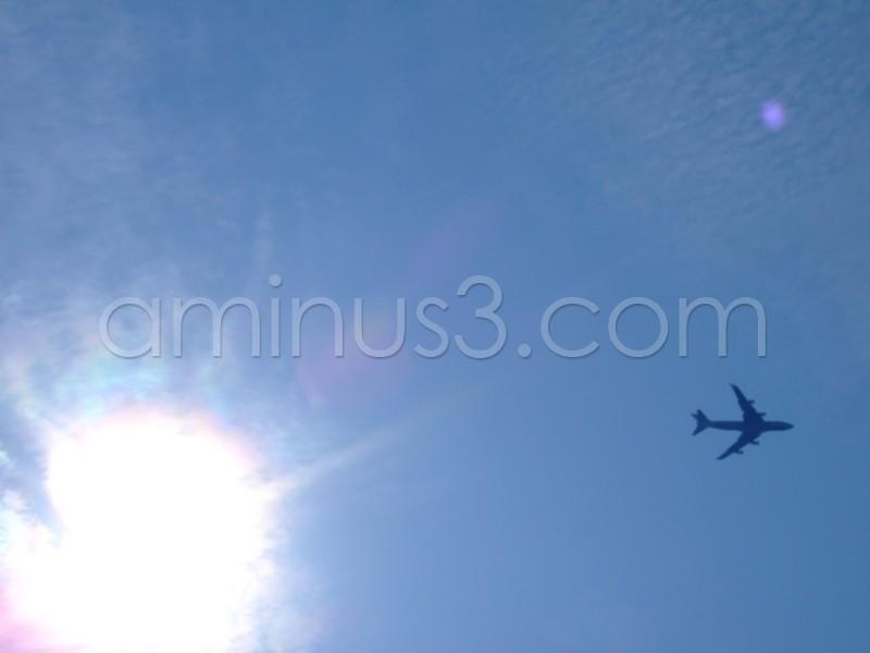 plane london sky sun hot
