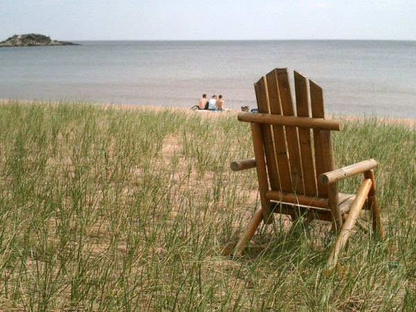 adirondack chair on the beach