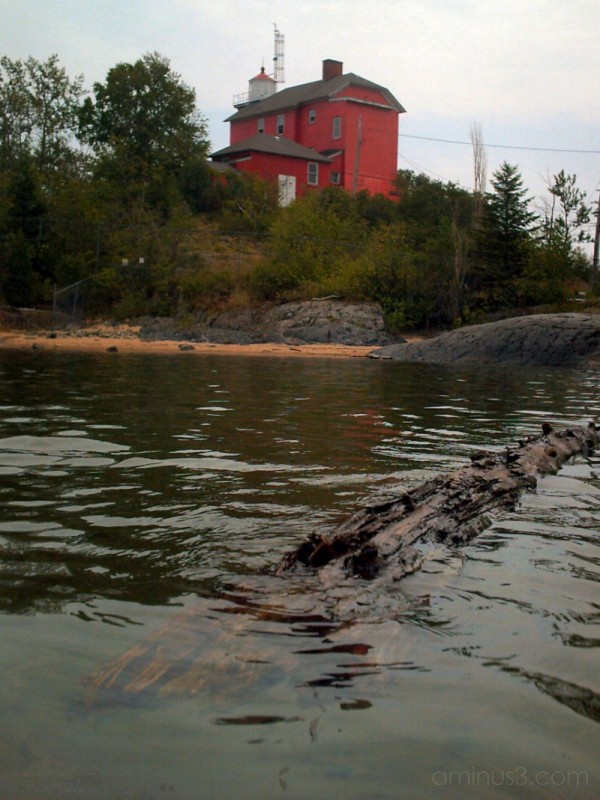Marquette Lighthouse and Log