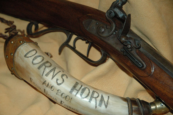 Custom flintlock rifle and powder horn