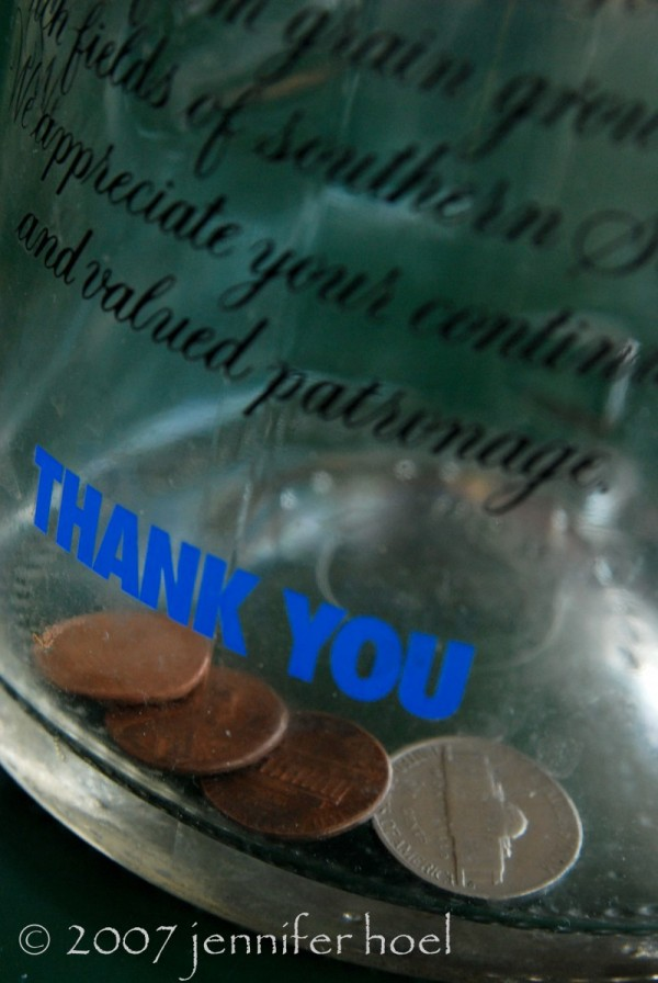 A photo of change in a tip jar