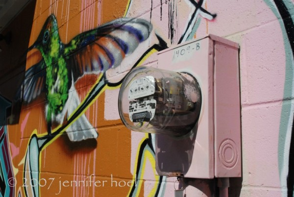 photo of a meter and grafitti art