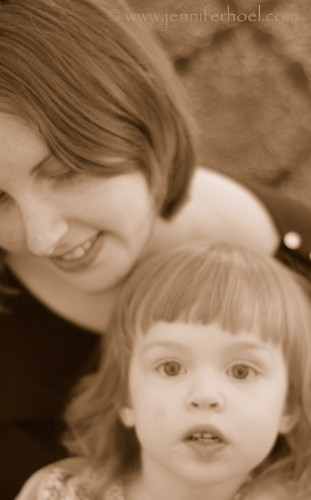 sepia photo of a mother and child