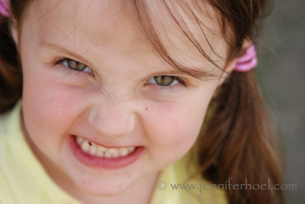 close up photo of a little girl snarling