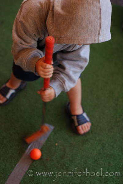 photo of a little boy putting