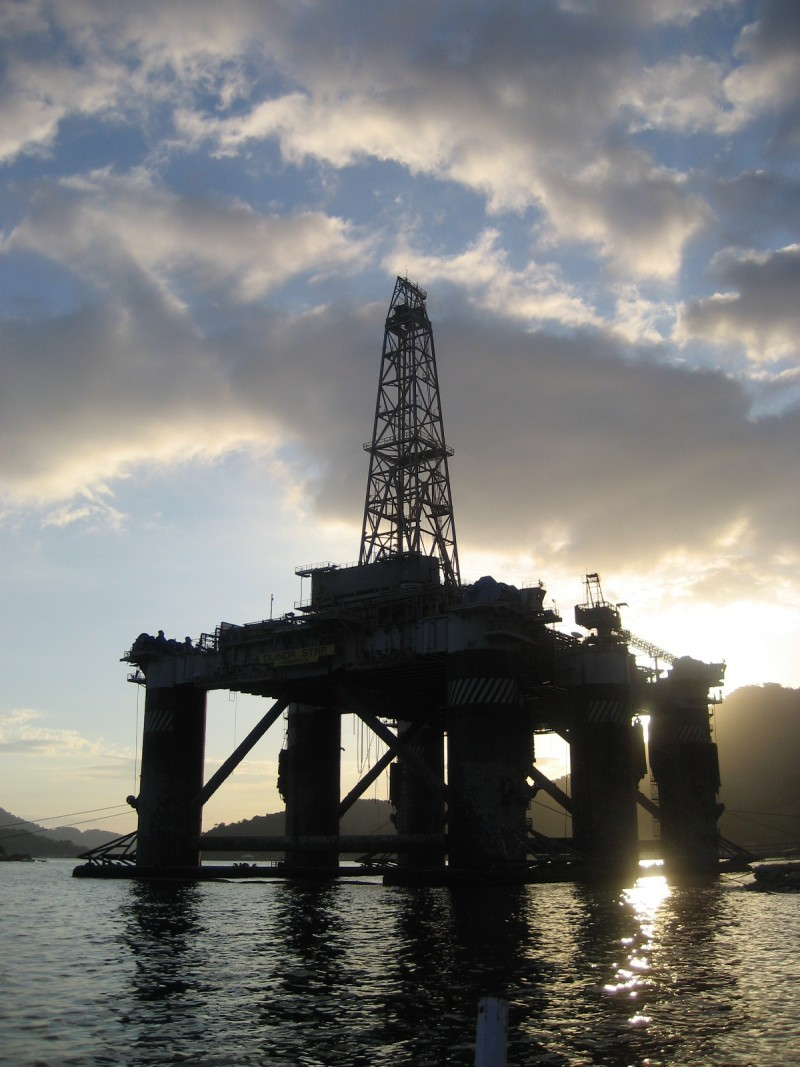 Sun behind Oil Rig