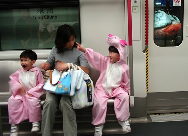 Two cute kids with piggy clothes