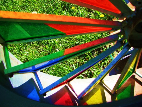 close up of the wheel on the stained glass bike