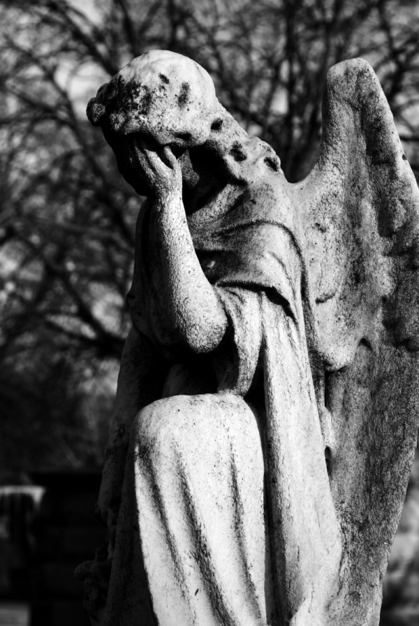 A grieving angel at Bohemian National Cemetery.