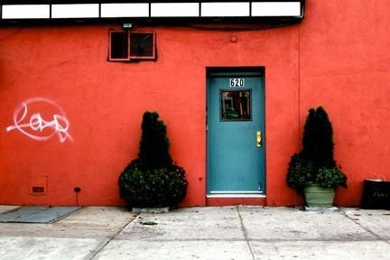 Red Wall, Blue Door, and a Zara Bag