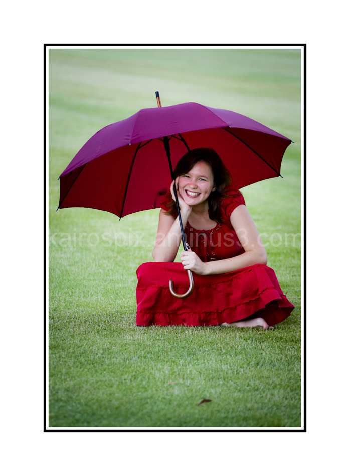Posing with a brolly...