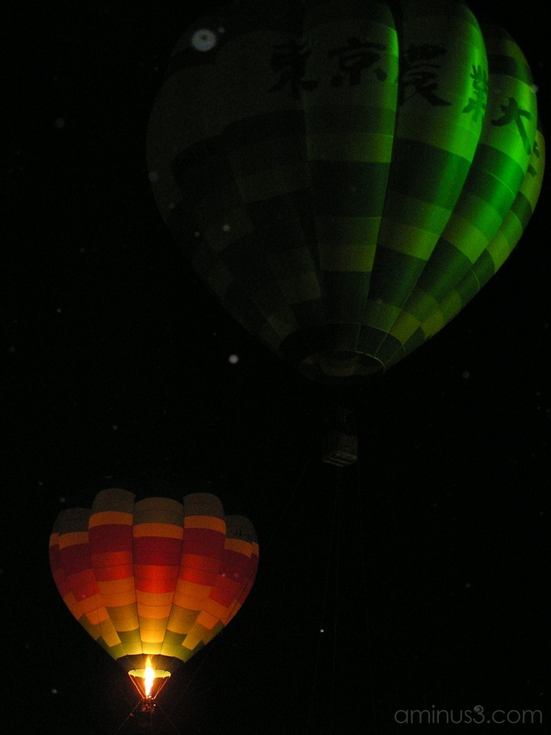 Night, snow and hot air balloons
