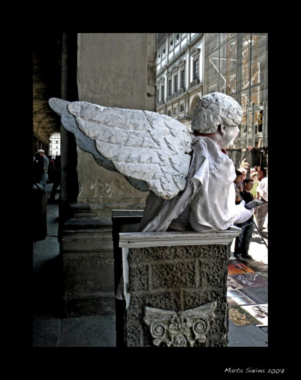 Cupido human statue