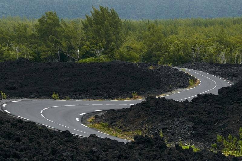 Sinuous road between volcanic rocks