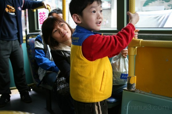 happy kid and his mother, macao