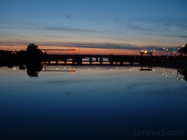 A sunset behind a bridge at Rimouski