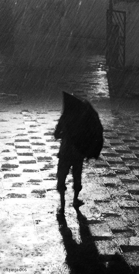 Man in monsoon rain