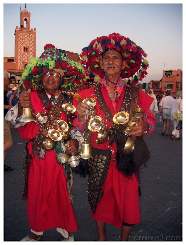 Cheerful, costumed water vendors in Marrakesh