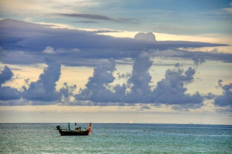 Fishing boat in the ocean off Phuket, Thailand