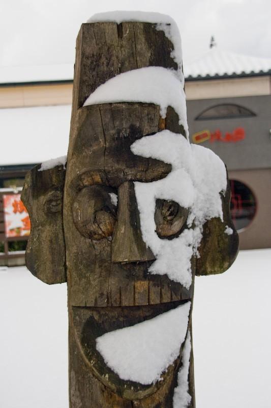 wooden face outside a restauraunt in Kanazawa