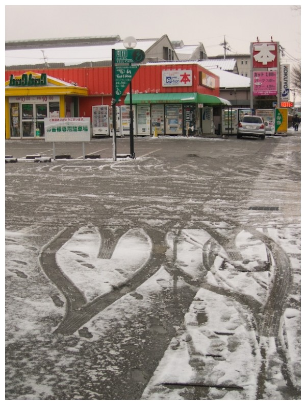 Heart shapes left by tyre tracks in the snow