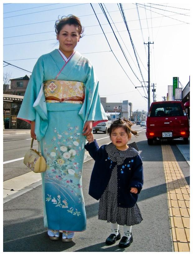 Mother walking her daughter to school